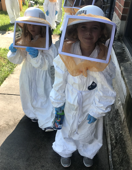 Bug Camp Particpants visiting Apiary wearing personal protective equipment.